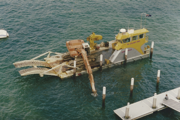 Underwater excavation from custom designed and built tug barge at Darling Point